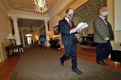 Gov. Polis walks through Capitol