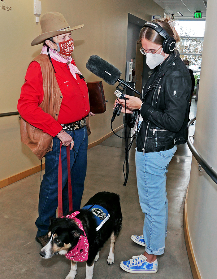Jude Gassaway and Bandit, being interviewed by Claire Crawford
