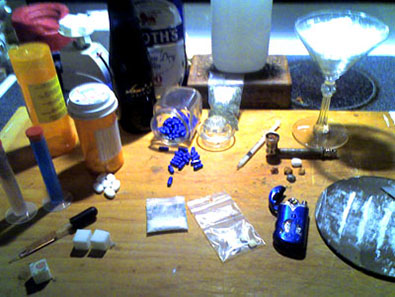 Collections of various drugs on table