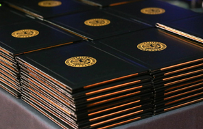 Diploma covers on table