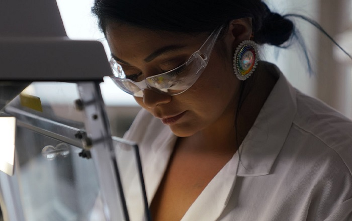 Student at microscope